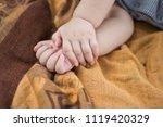 body part of baby when sleep.... | Shutterstock . vector #1119420329