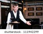 handsome man waiter in uniform... | Shutterstock . vector #111942299