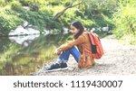 lonely sad woman hug her knee...   Shutterstock . vector #1119430007