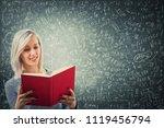 teacher holding a red book in...   Shutterstock . vector #1119456794