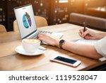 close up the hand of an asian... | Shutterstock . vector #1119528047