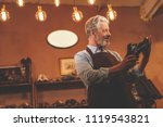 an elderly shoemaker with a... | Shutterstock . vector #1119543821