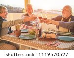group of happy senior friends... | Shutterstock . vector #1119570527