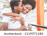 happy young mother having fun... | Shutterstock . vector #1119571184