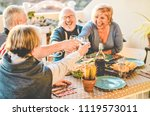 group of happy senior friends... | Shutterstock . vector #1119573011