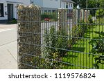 modern privacy fence of natural ... | Shutterstock . vector #1119576824