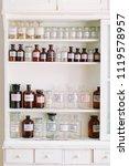 bottles on the shelf in old... | Shutterstock . vector #1119578957