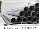 New gray plastic sewer and drain pipes in the truck - stock photo