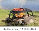 fried sausage cooking in the... | Shutterstock . vector #1119648824