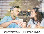 couple talking and using... | Shutterstock . vector #1119664685
