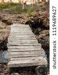 old wooden bridge over the...   Shutterstock . vector #1119689627