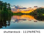 Stock photo reflection of a sunset by a lagoon inside the amazon rainforest basin the amazon river basin 1119698741