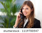 young secretary on the phone in ... | Shutterstock . vector #1119700547