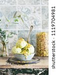bowl of pistachio ice cream...   Shutterstock . vector #1119704981