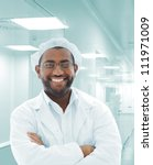 Portrait of African doctor in modern hospital - stock photo
