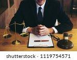 judge gavel with justice... | Shutterstock . vector #1119754571