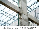 concrete column and beam construction site background - stock photo