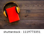 audiobooks concept. headphones... | Shutterstock . vector #1119773351