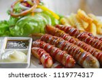 mix sausage with fried potato... | Shutterstock . vector #1119774317