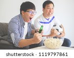 people watch soccer. asian... | Shutterstock . vector #1119797861