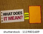 Small photo of Handwriting text writing What Does It Mean Question. Concept meaning Confusion Curiosity Questioning Inquire Jute sack deck white page show words red lend yellow note mid equal mark.