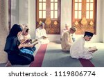 muslims reading from the quran | Shutterstock . vector #1119806774