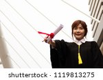 Small photo of Beautiful Graduate graduates woman smile and are happy after graduation.