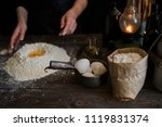 hands working with dough... | Shutterstock . vector #1119831374