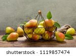 fresh pears with leaves in a... | Shutterstock . vector #1119857474