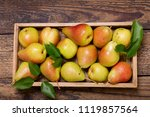 fresh pears with leaves in a... | Shutterstock . vector #1119857564