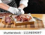 cook chef hands puts ham on... | Shutterstock . vector #1119859097