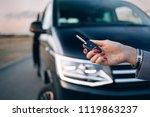 woman is holding car keys in... | Shutterstock . vector #1119863237