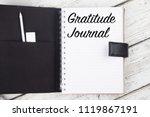 gratitude journal on white wood ...   Shutterstock . vector #1119867191