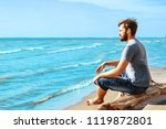 a young man with a beard... | Shutterstock . vector #1119872801
