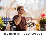young man drinking a coffee | Shutterstock . vector #1119898901
