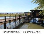 bridge and stilt houses on a... | Shutterstock . vector #1119916754