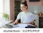 young woman managing domestic... | Shutterstock . vector #1119919919