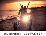 attractive couple driving buggy ...   Shutterstock . vector #1119927617