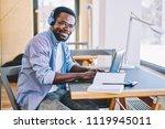 cheerful dark skinned male... | Shutterstock . vector #1119945011