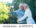 happy senior couple taking a... | Shutterstock . vector #1119957971