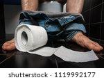man suffers from diarrhea is... | Shutterstock . vector #1119992177