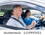 young woman on a driving test... | Shutterstock . vector #1119992921