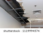ceiling panels damaged hole in... | Shutterstock . vector #1119994574
