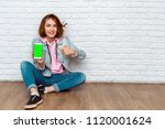 portrait of a happy casual... | Shutterstock . vector #1120001624