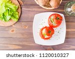 fresh tomatoes baked with... | Shutterstock . vector #1120010327