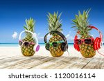 Fresh Pineapple On Beach And...