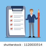 man stands with big check list  ... | Shutterstock .eps vector #1120033514