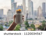 young woman eating chia pudding ... | Shutterstock . vector #1120034567