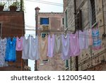 Stock photo clothes hanging to dry on a clothes line 112005401