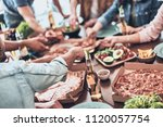 so hungry. close up of young... | Shutterstock . vector #1120057754